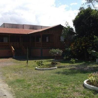 Terreno Urbano com 02 Casas de Madeira